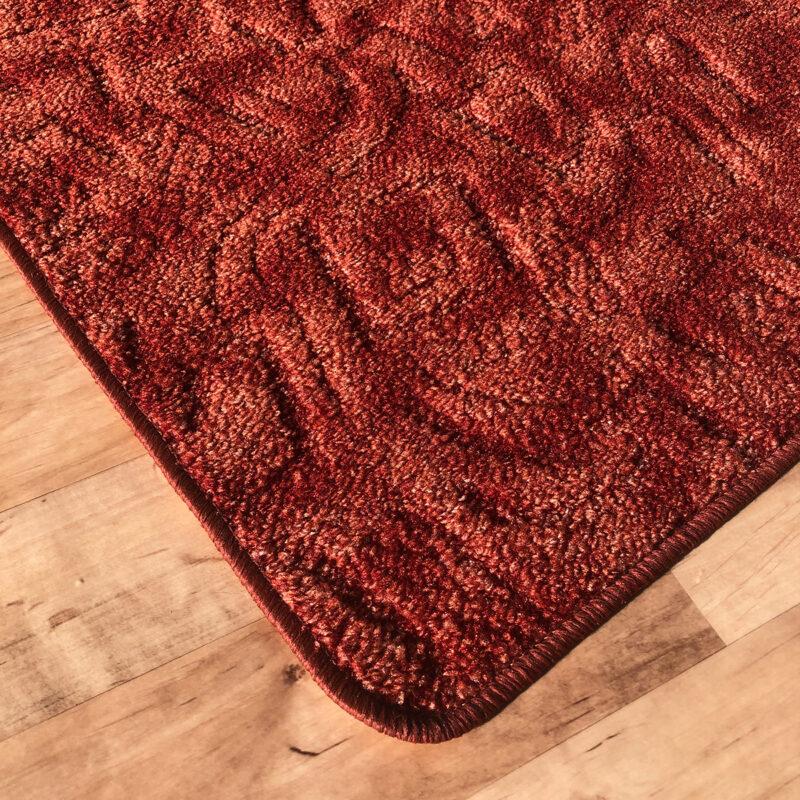 Szegett szőnyeg - Korallvörös színben absztrakt mintával - sarok